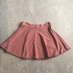 Pink and black striped skirt